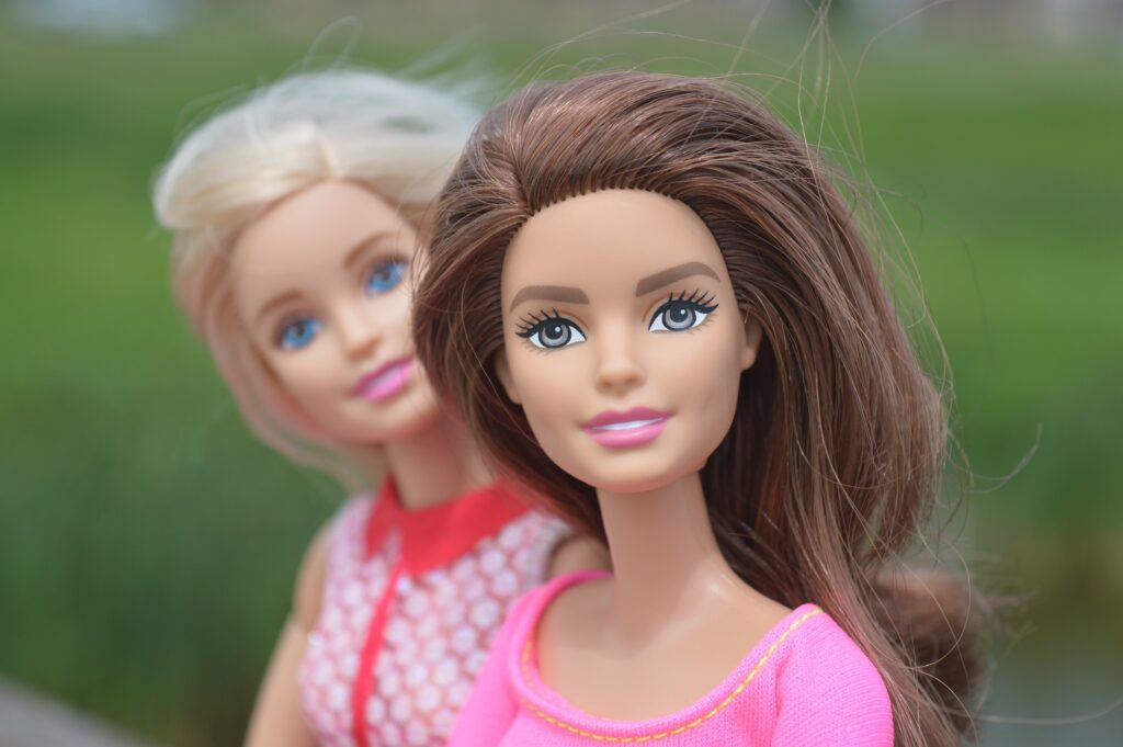 brunette and blonde Barbie dolls