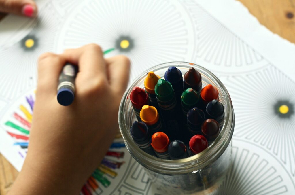 A child using crayons