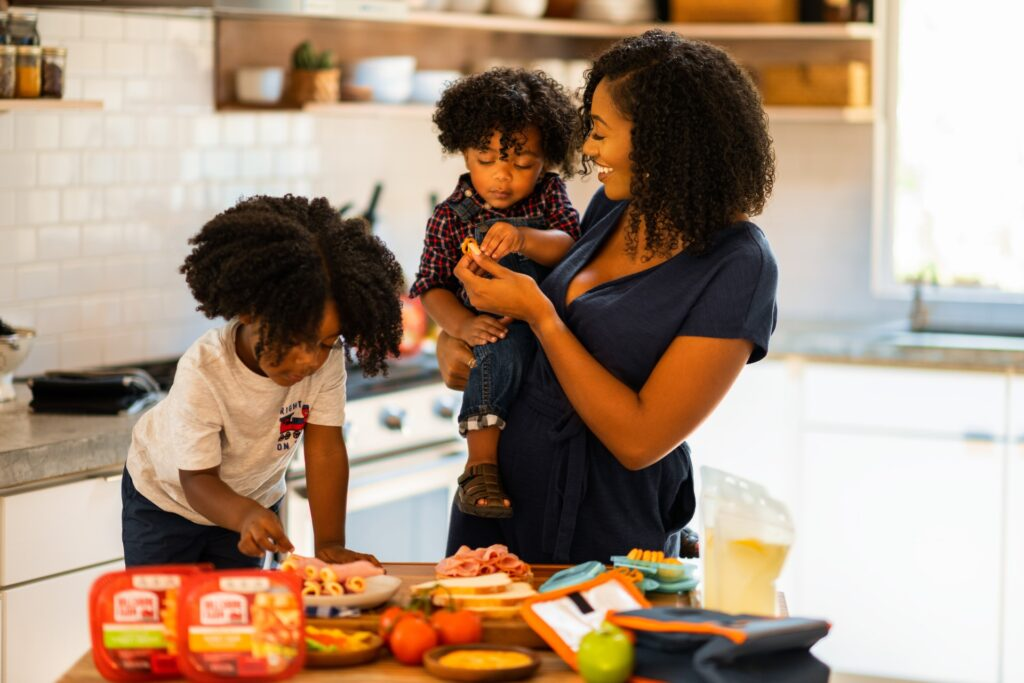 mother and children eating in the kitchen